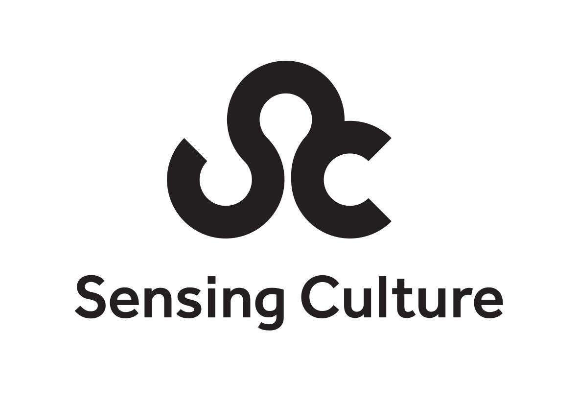 """Accessible logo with the words """"Sensing Culture"""" in bold, black lettering. Above these words are the interlocked letters """"S"""" and """"C"""", also in bold, black lettering"""