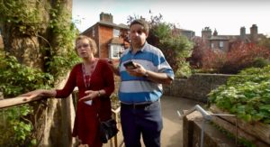 Lewes Castle try out app. Photograph of a BPS visitor and a Museum worker testing out the app audio guide