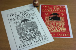 "Tactile image with braille Conan Doyle Collection. A tactile version of the print cover for the first edition (1902) of ""The Hound of the Baskervilles"".]"