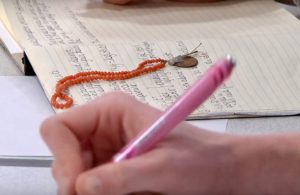 Photograph of someone Writing as part of audio description training.